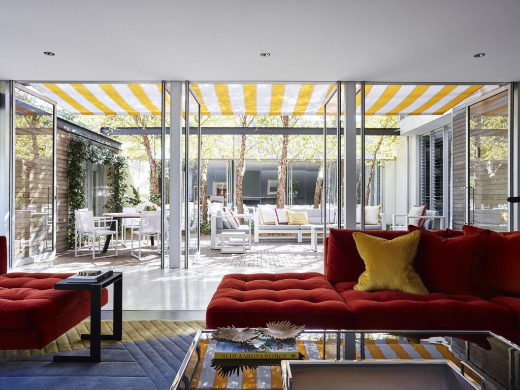 The Holdsworth project featuring a custom rug by Designer Rugs that complements the 'Palm Springs' style interior.