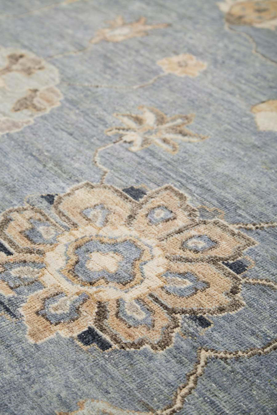 Detailed image of floral Cadiz rug in blue colour