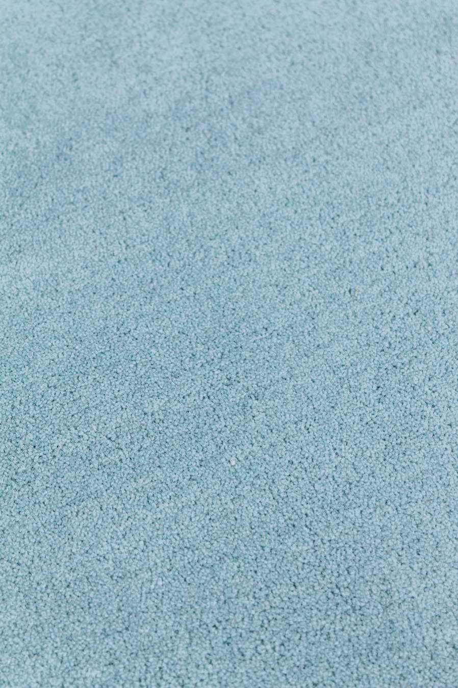 Close up view of textured Newby rug in light blue colour