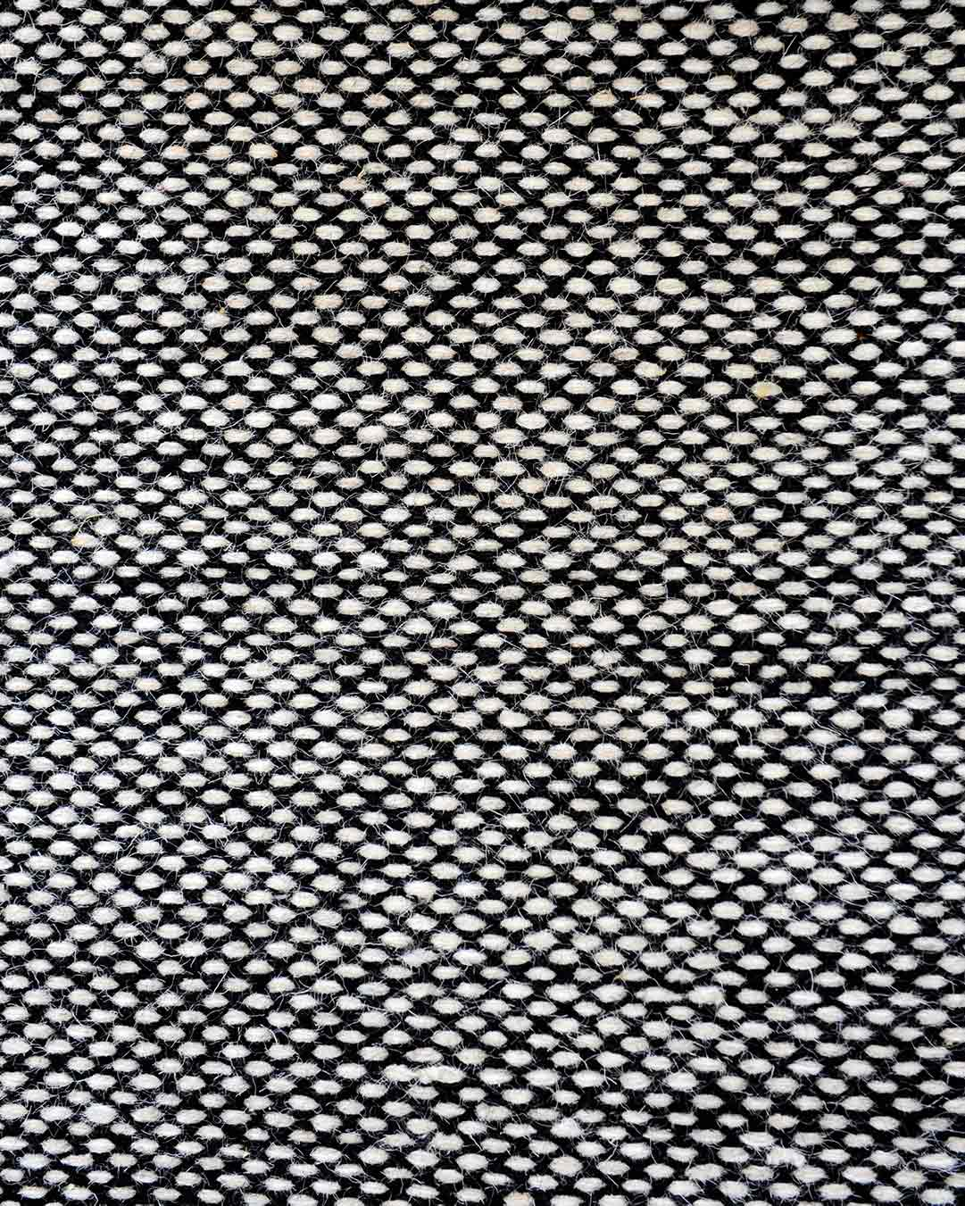 Detailed view of textured Suki rug in grey colour