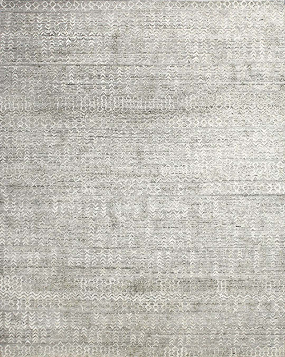 Overhead image of patterned Everly rug in beige colour