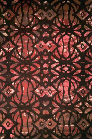 Overhead image of art nouveau Jatropha rug in burgundy colour