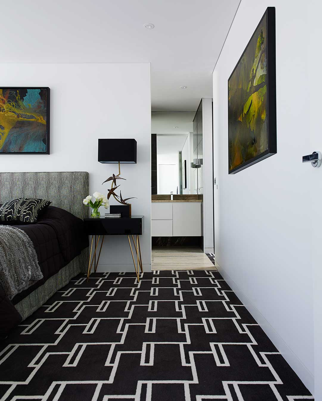 Bedroom view of Dianne black and white patterned Axminster carpet by Greg Natale