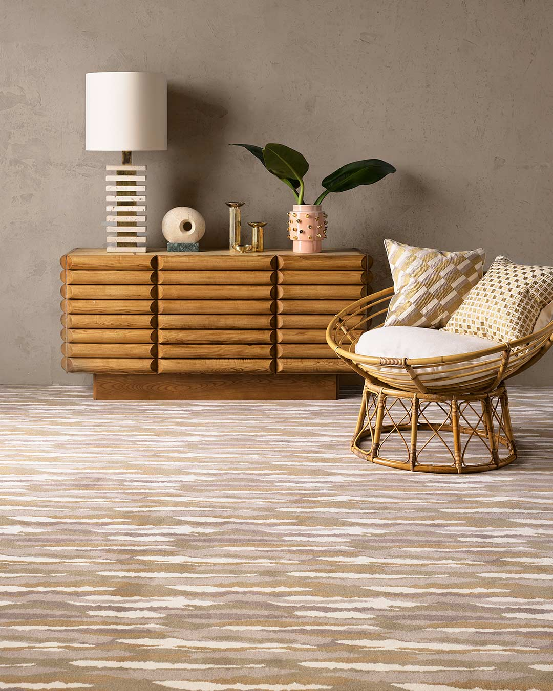 Living room view of Drift brown patterned Axminster carpet by Greg Natale