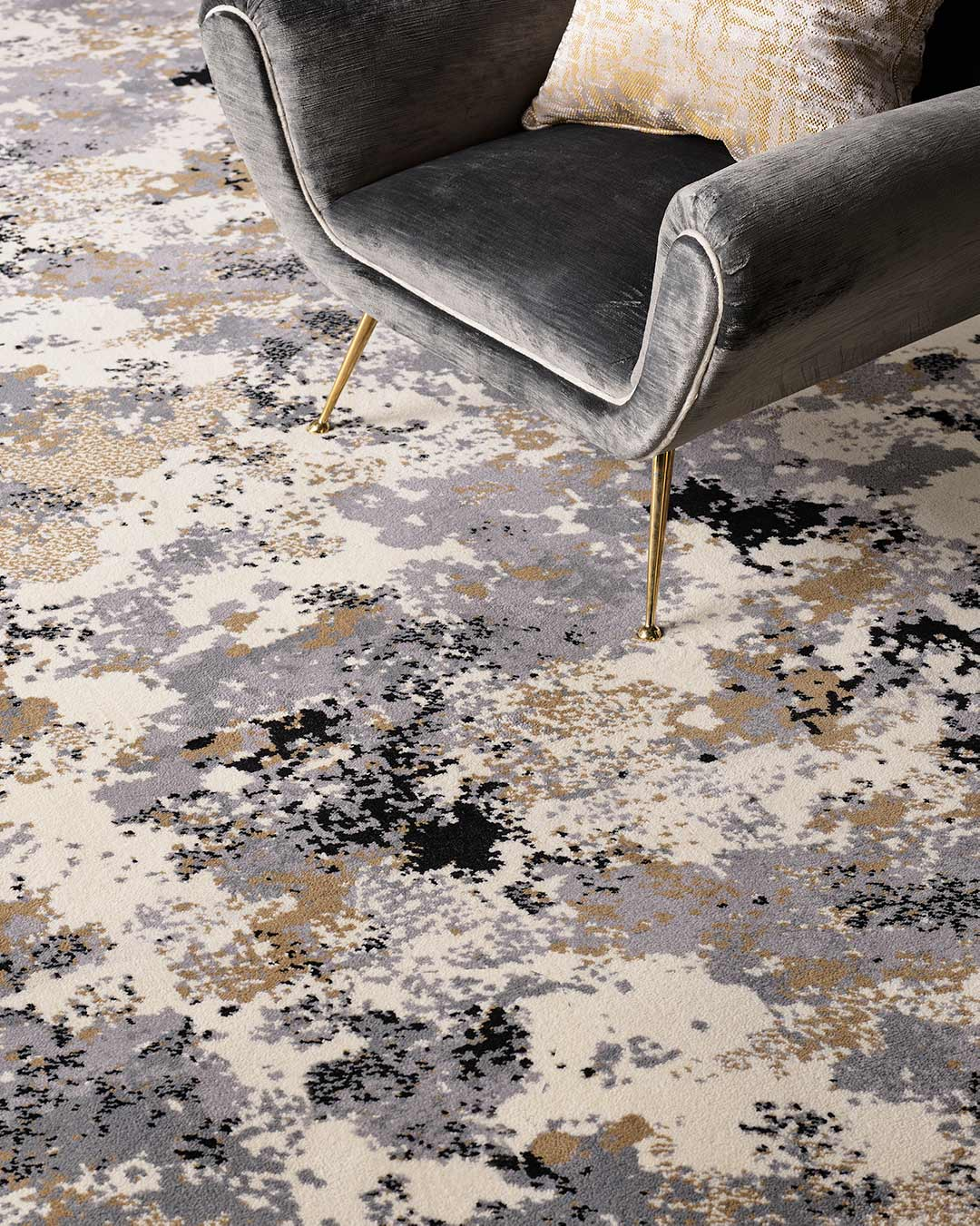 Close up view of Fizz grey and gold patterned Axminster carpet by Greg Natale