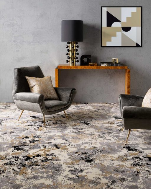 Living room view of Fizz grey and gold patterned Axminster carpet by Greg Natale