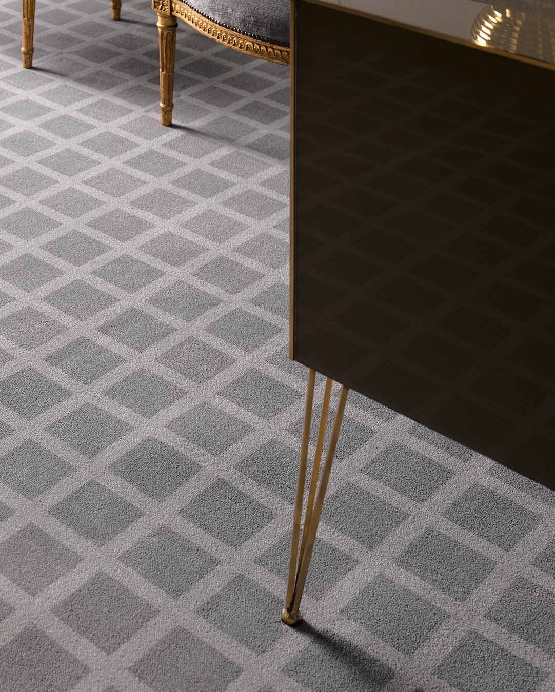 Close up view of Match grey geometric Axminster carpet by Greg Natale
