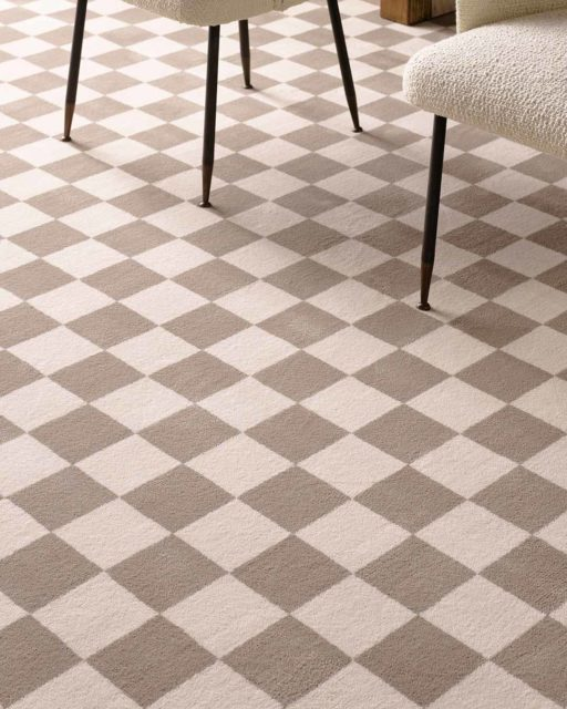 Close up view of Match checked grey Axminster carpet by Greg Natale