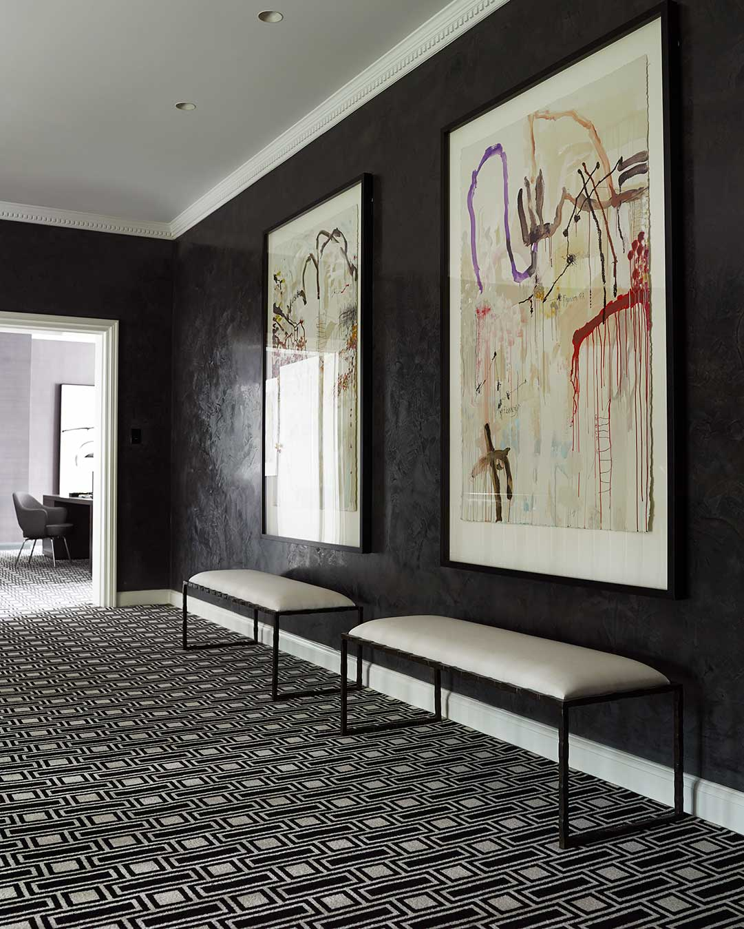 Hallway view of Tom black and white geometric Axminster carpet by Greg Natale