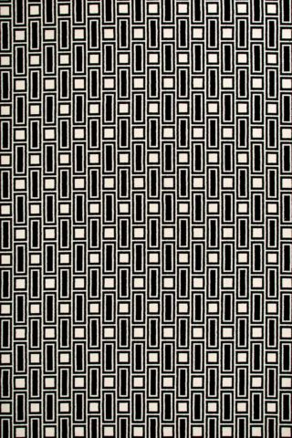 Overhead view of Tom black and white geometric Axminster carpet by Greg Natale