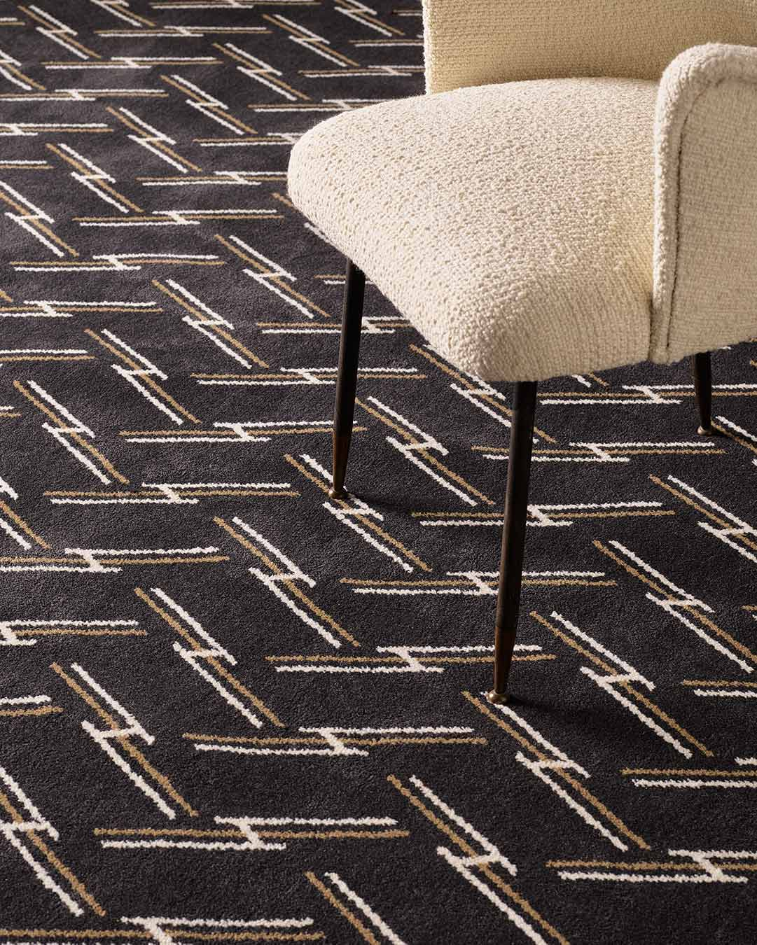 Close up view of Windsor brown geometric Axminster carpet by Greg Natale