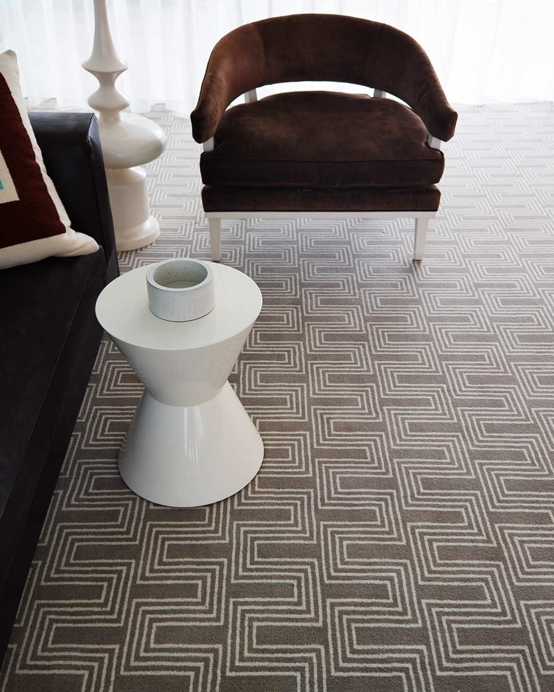 Close up view of Yves beige patterned Axminster carpet by Greg Natale