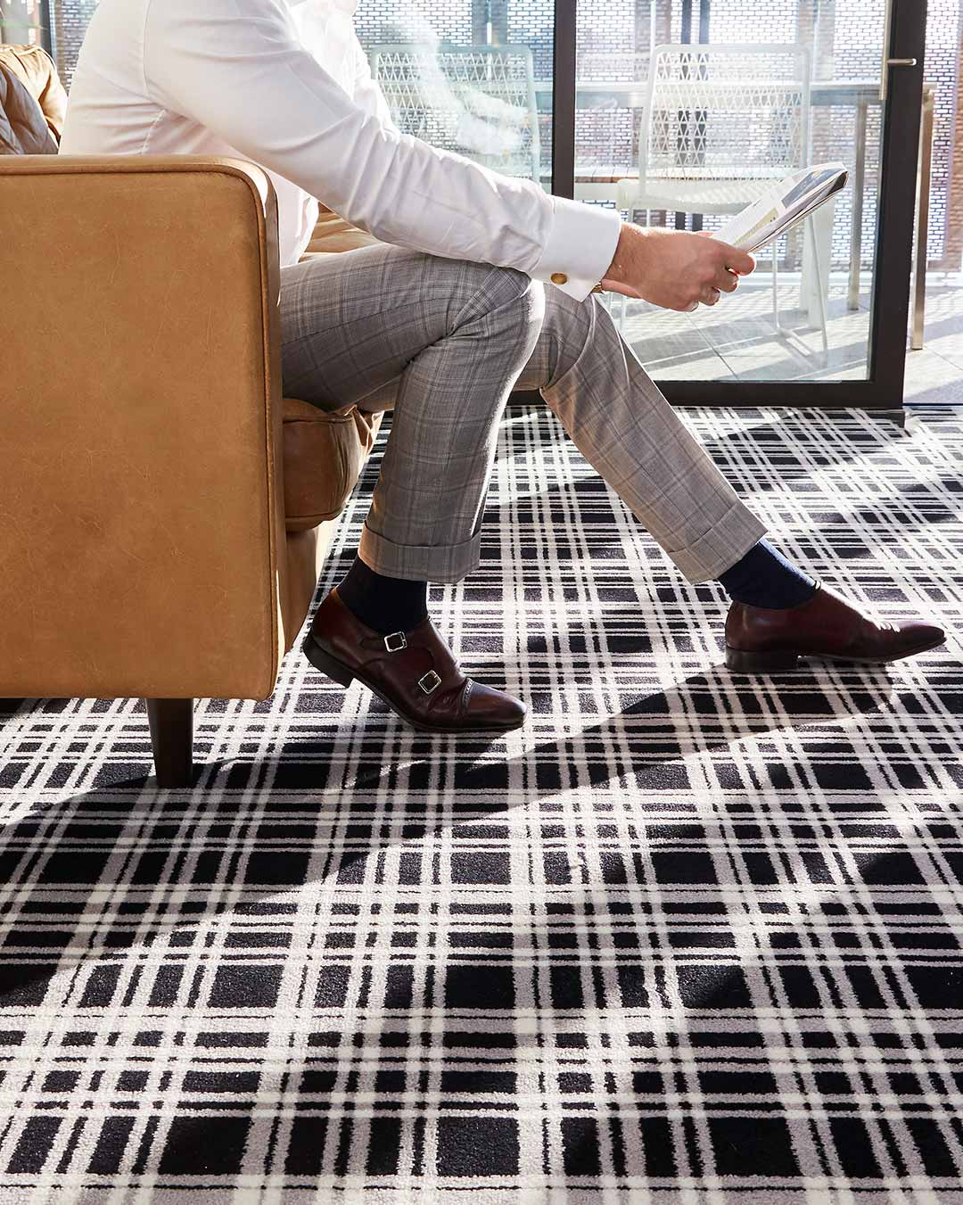 Close up living room view of Alford black and white tartan Axminster carpet