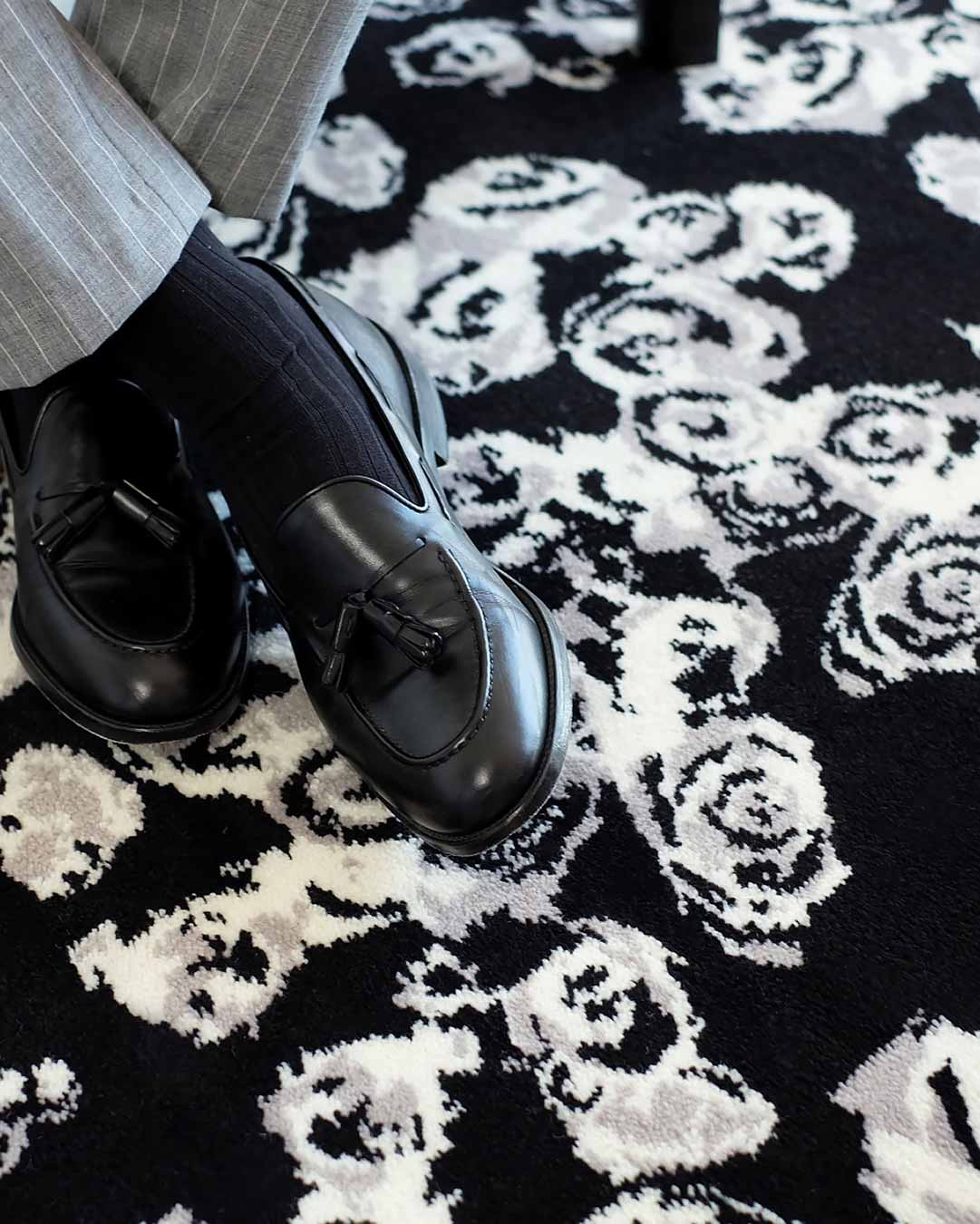 Close up image of Iona black and white floral Axminster carpet