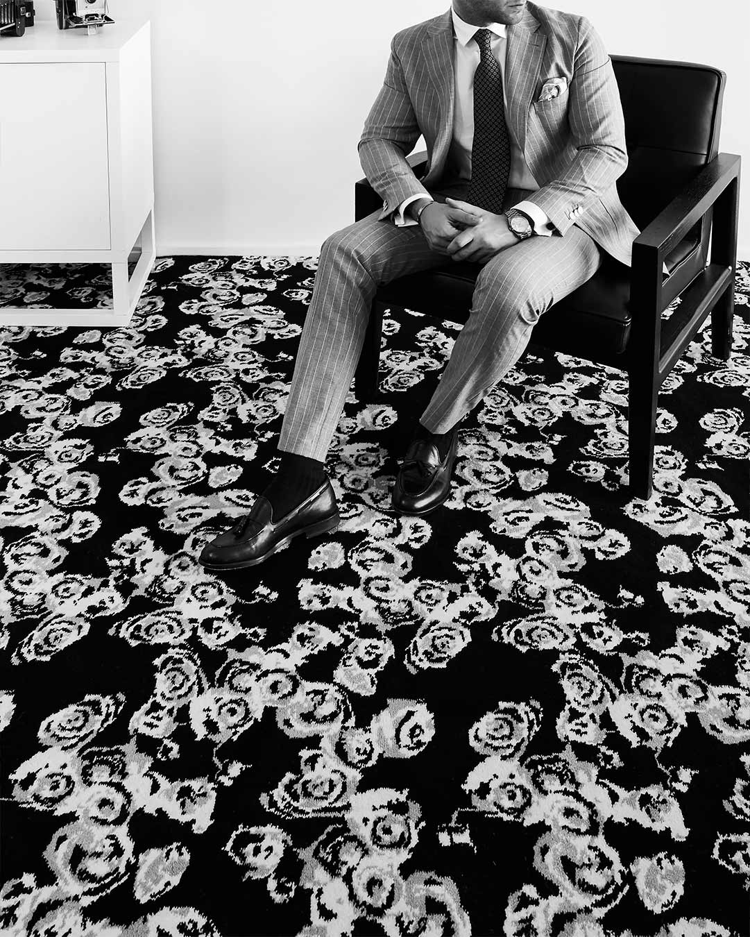 Living room image of Iona black and white floral Axminster carpet