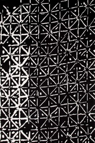 overhead of batik rug by akira with a black background and white dots and dashes pattern