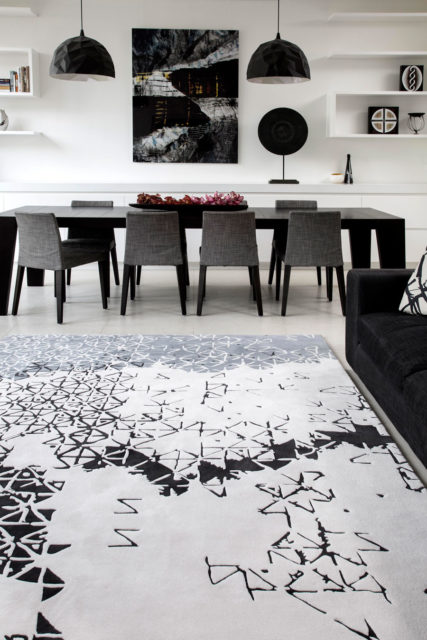 location shot of living room of batik ubud rug by akira in white black and grey pattern