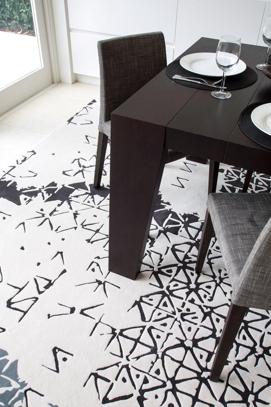 close up of batik ubud rug by akira in white black and grey pattern