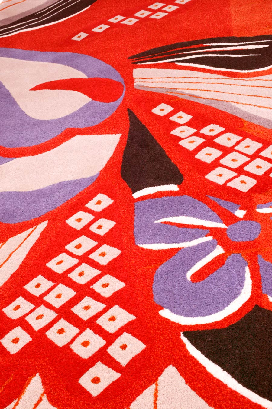 close up of kyoto 2 rug by akira in red floral pattern