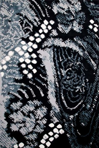 overhead of shibori rug by akira in black and grey abstract pattern
