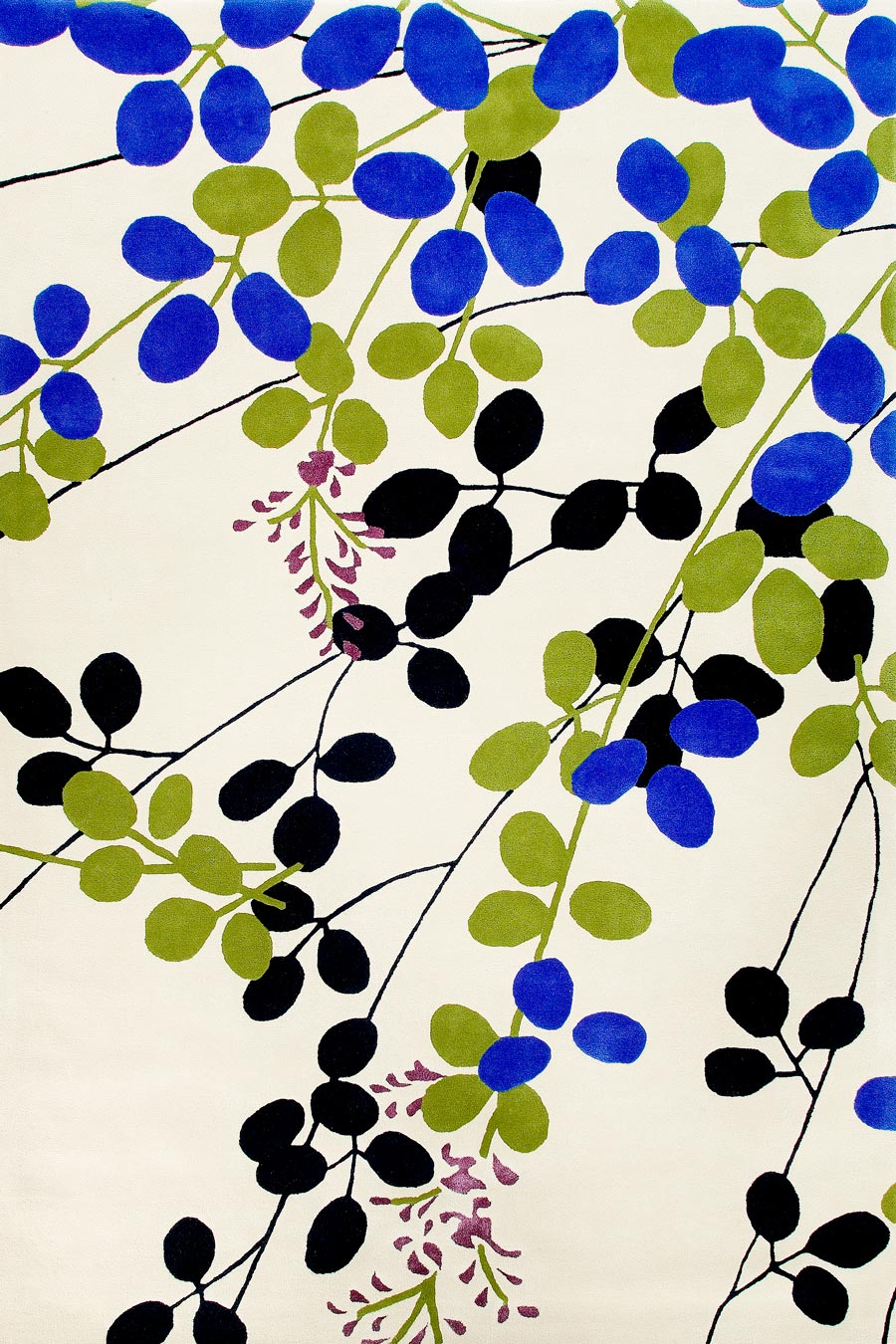 overhead of shoka rug by akira with beige background and green and blue leaf pattern