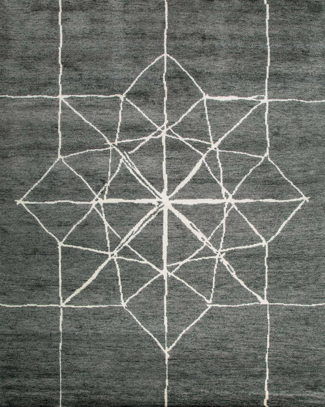 overhead of berkano rug by anna carin in grey with white lines