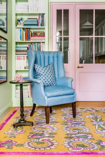 location shot of kandilli rug by anna spiro in abstract floral pattern mustard background and pink border
