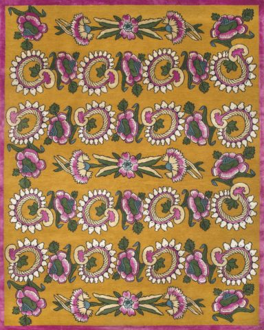 overhead of kandilli rug by anna spiro in abstract floral pattern mustard background and pink border