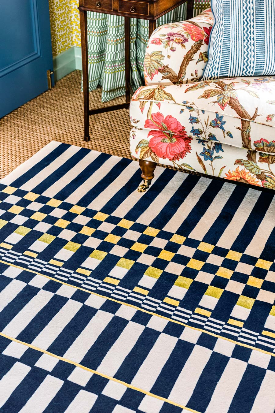 close up shot of otto rug by anna spiro in navy and white geometric pattern