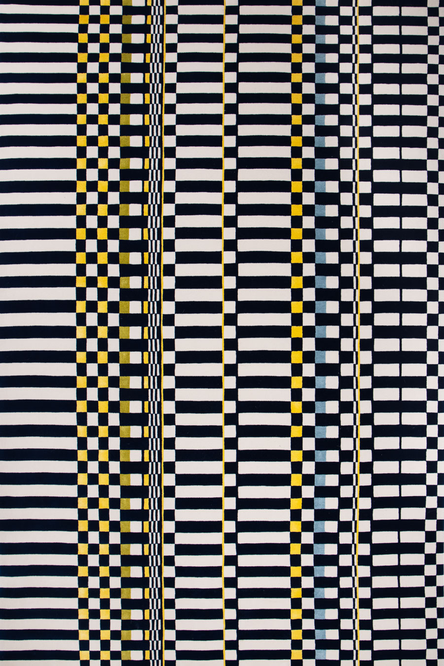 overhead of otto rug by anna spiro in navy and white geometric pattern