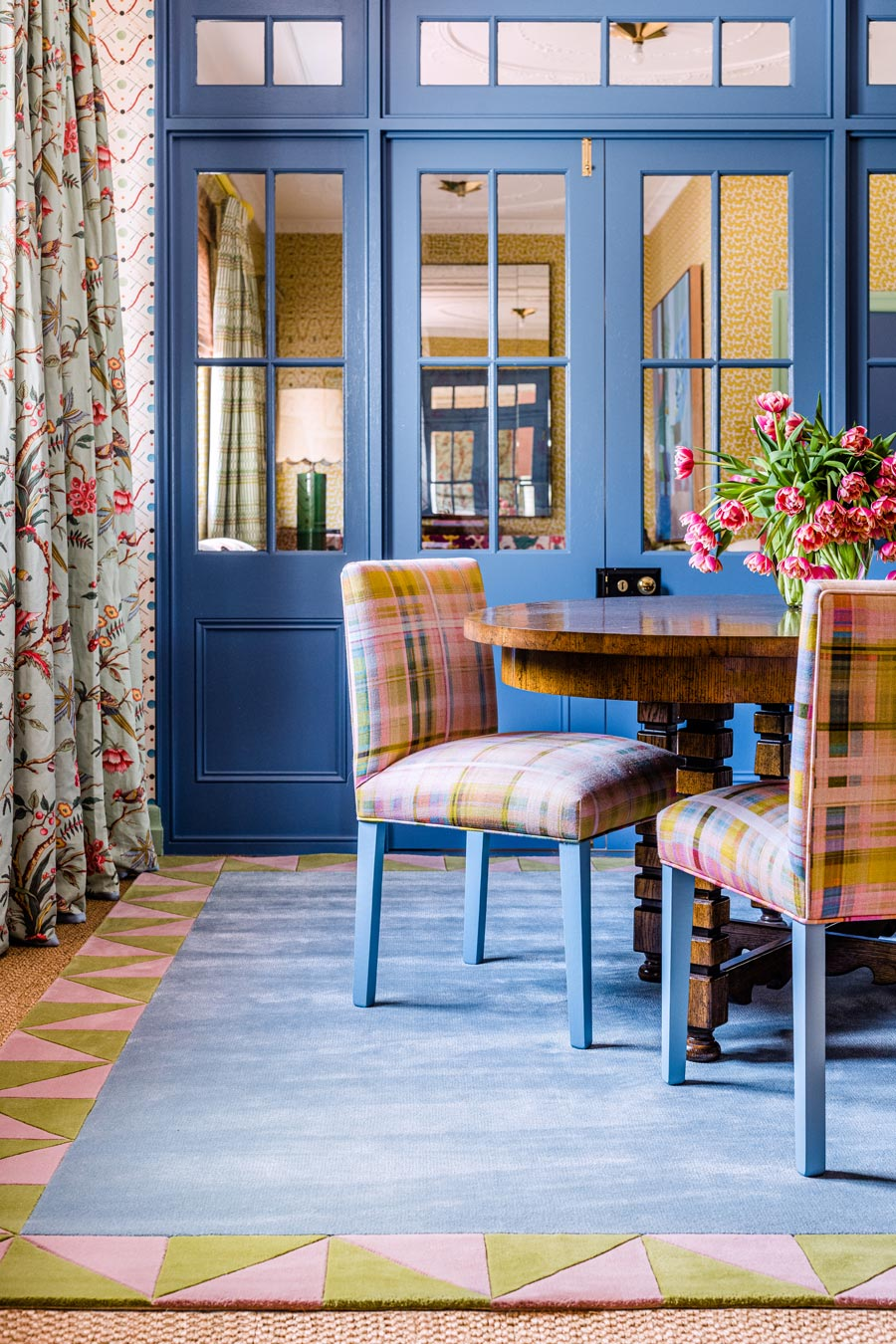 location dining room shot of ziggy rug by anna spiro with geometric border and blue centre