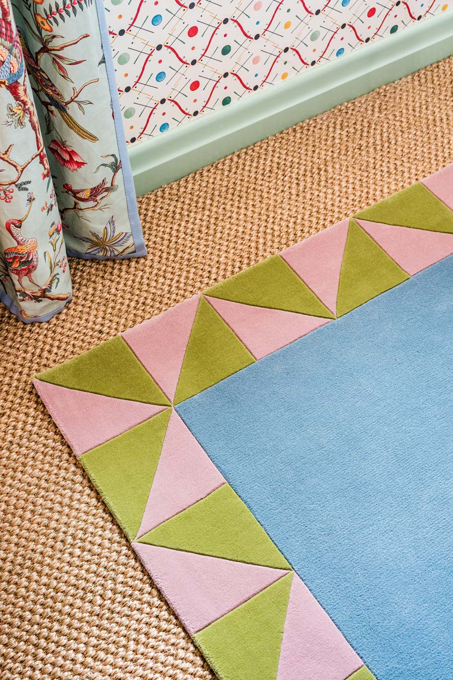 close up of ziggy rug by anna spiro with geometric border and blue centre