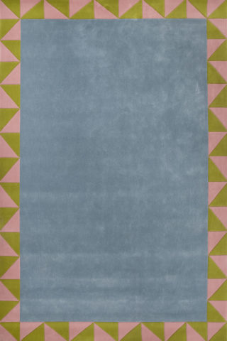 overhead of ziggy rug by anna spiro with geometric border and blue centre