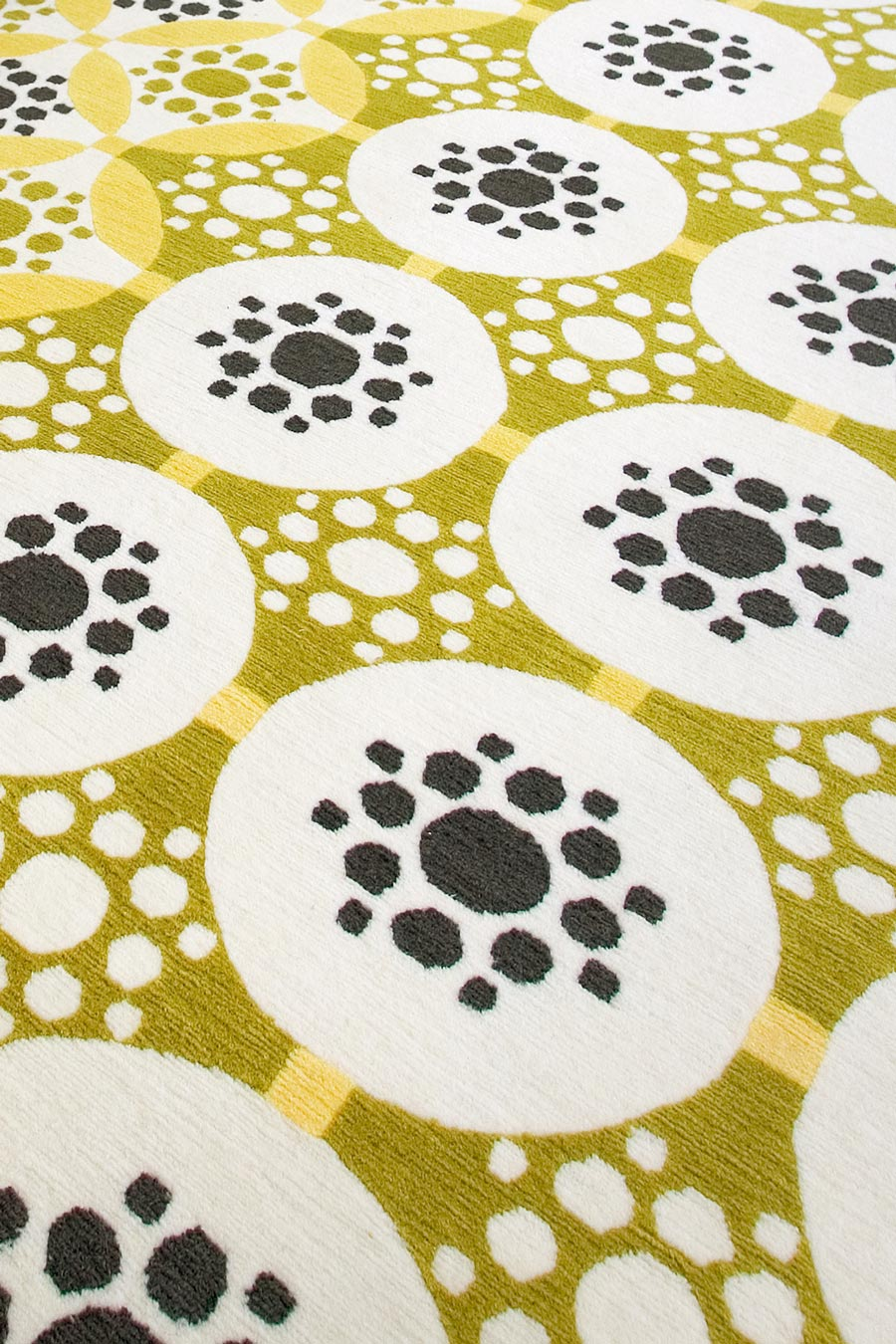 close up of applique rug by bernabeifreeman in yellow circular pattern