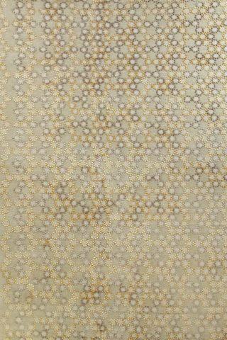 overhead of folk rug by bernabeifreeman in yellow and beige circular pattern