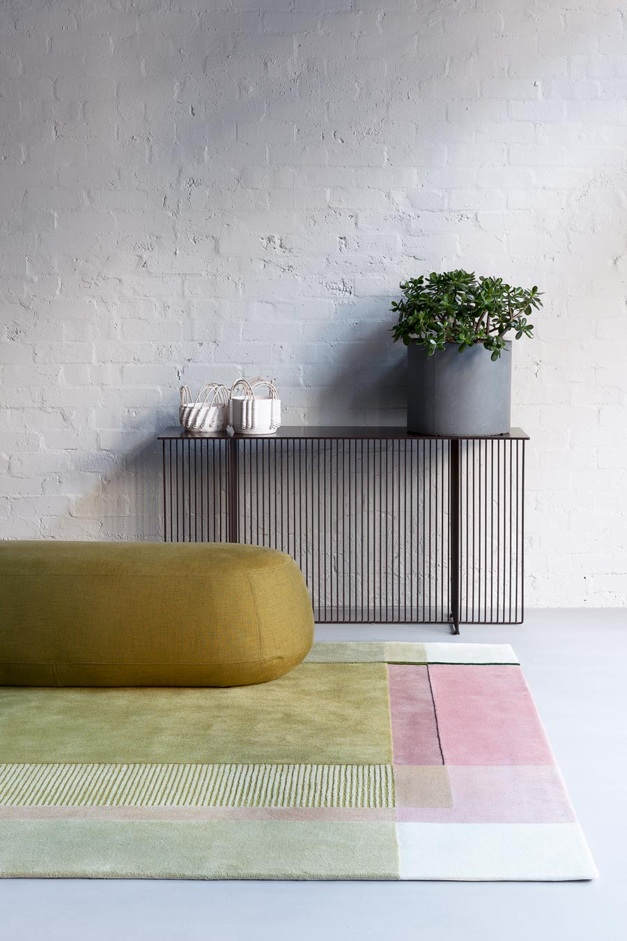 location shot of spring rug by bernabeifreeman green and pink colour block