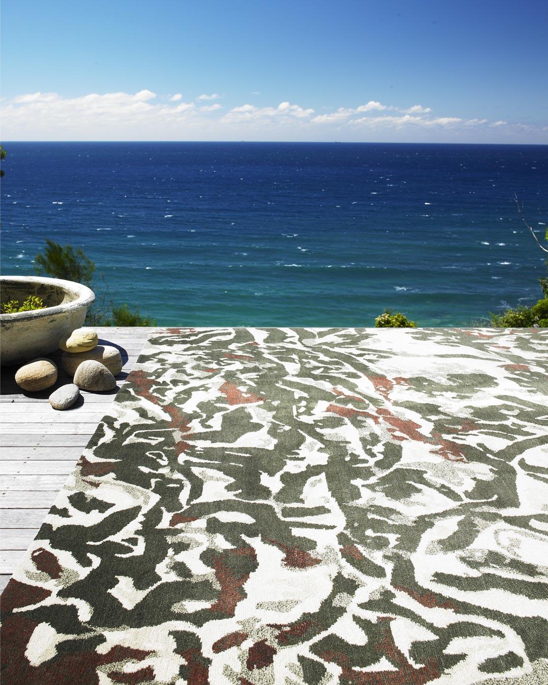 location shot of black map rug by caroline baum beige background organic green lines