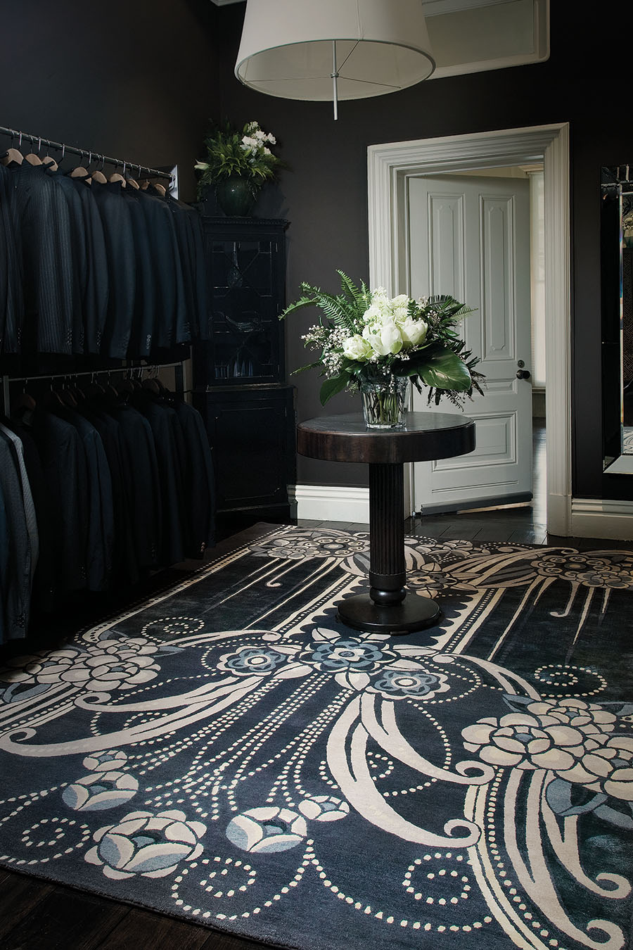 location wardrobe shot of black pearl rug by catherine martin art deco style