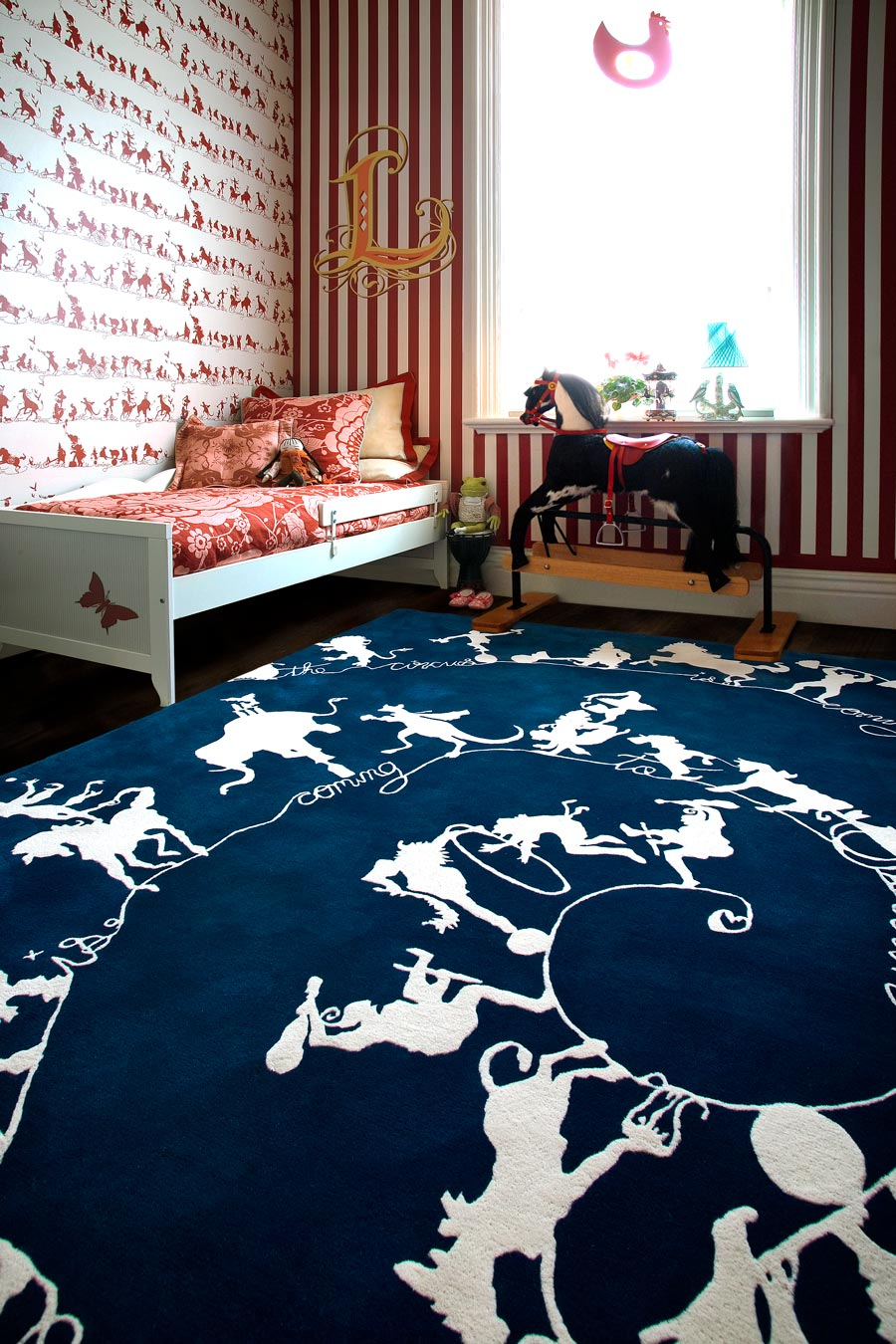overhead of circus silhouettes rug by catherine martin white on navy background