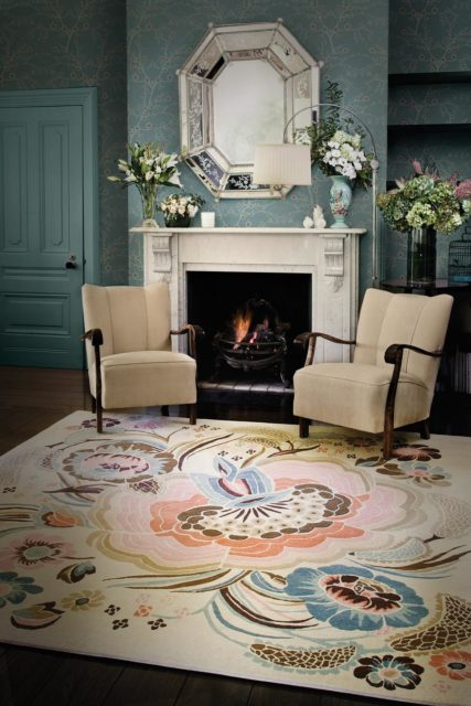 location living room shot of garden party rug by catherine martin multicoloured floral with beige background