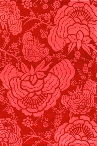 overhead of peony rug by catherine martin red floral pattern