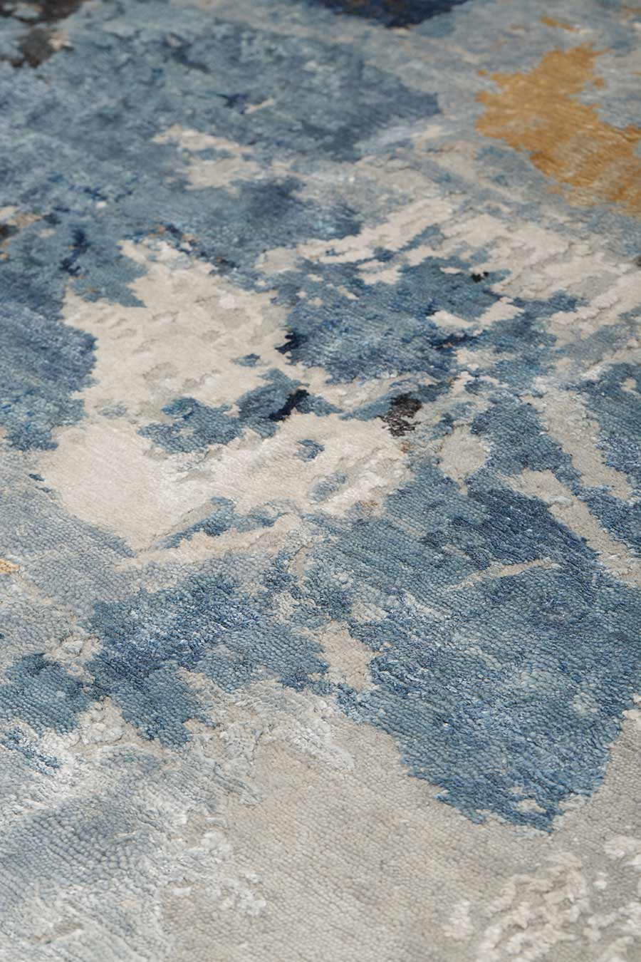 Close up image of blue handknot Salacia's Spring rug by Derry Tal