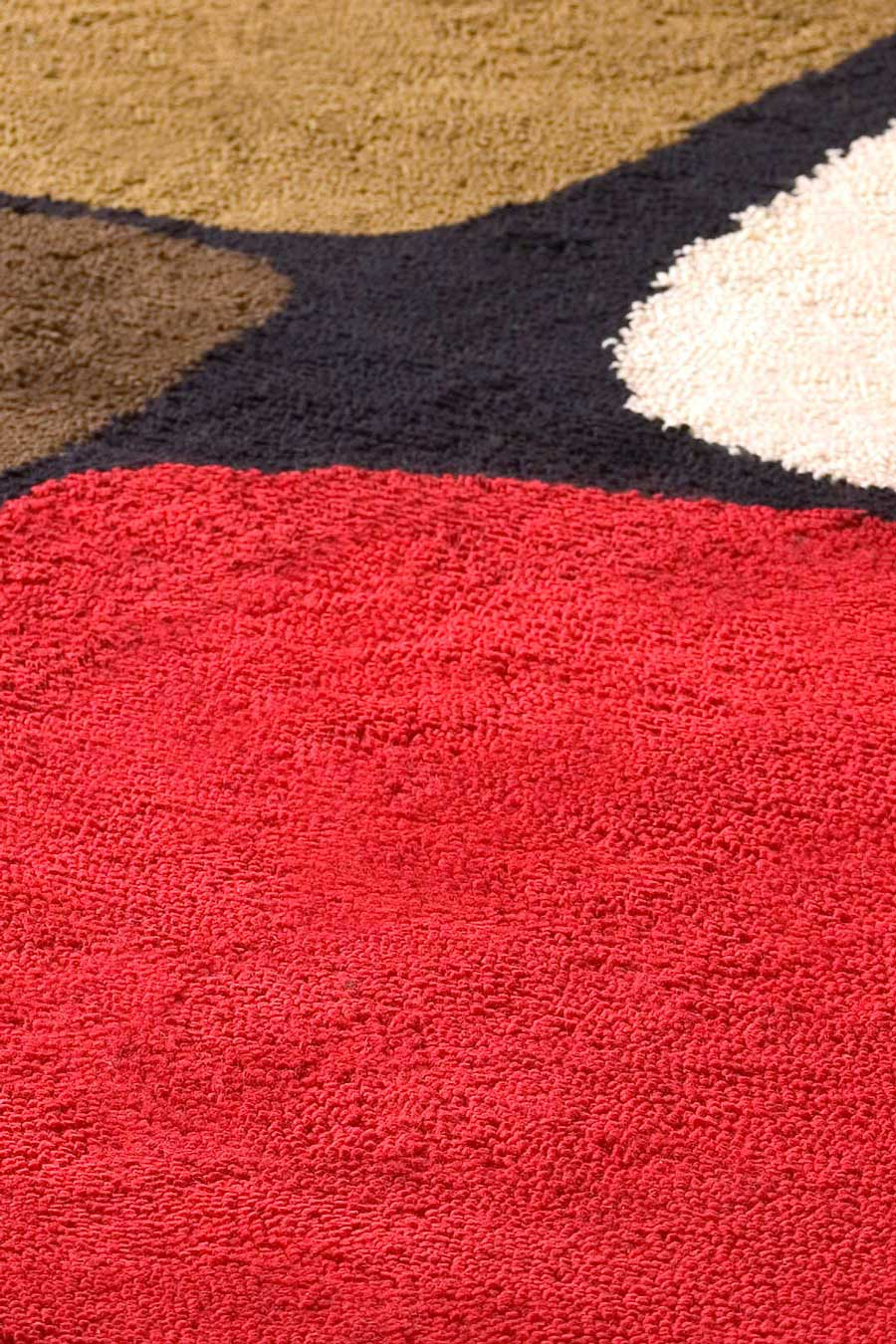 close up of boulder 1 rug by dinosaur designs red brown