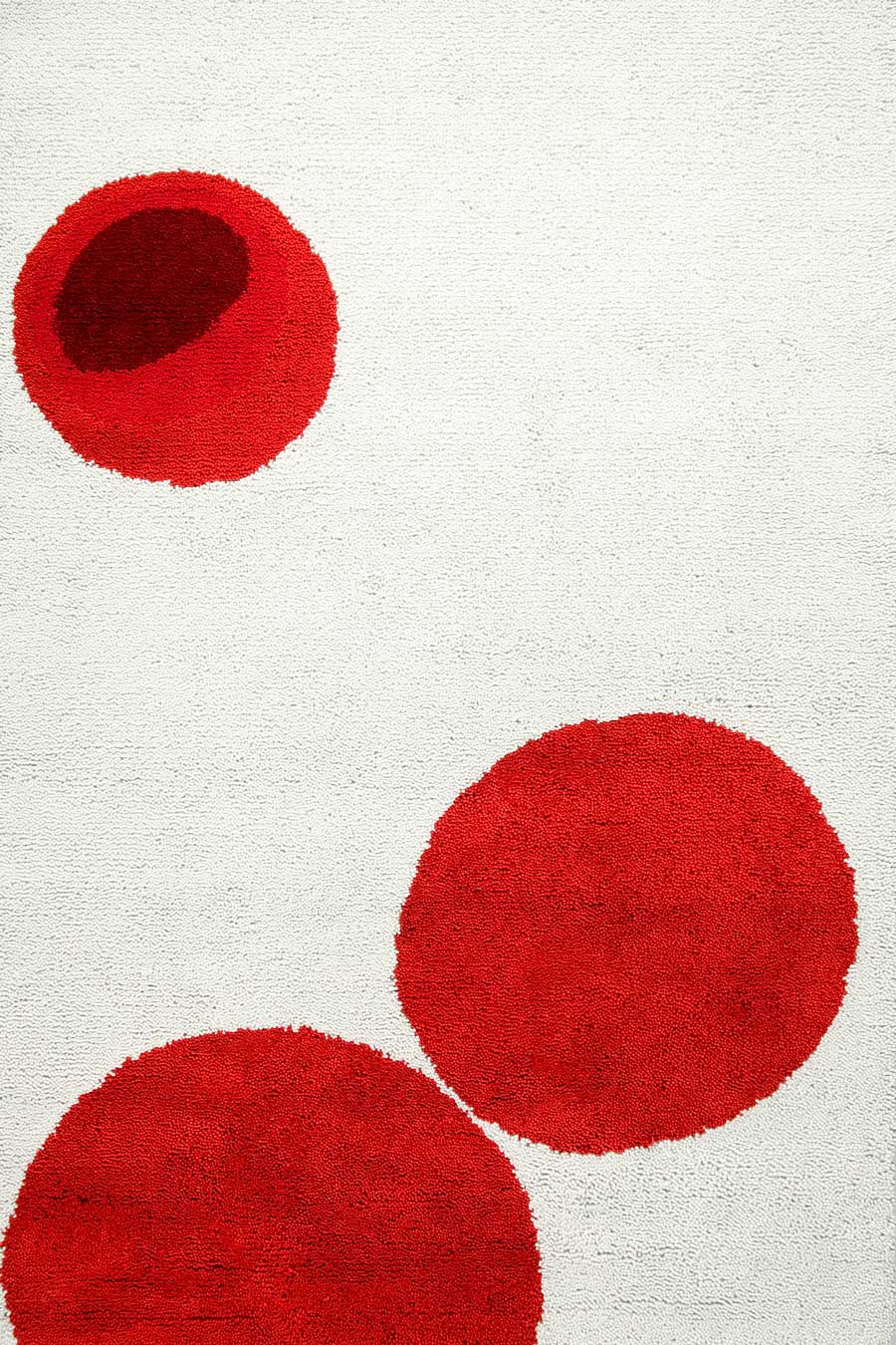 overhead of drops rug by dinosaur designs red dots on white background