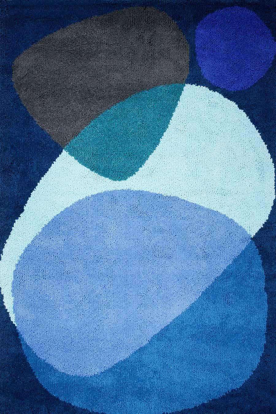 overhead of luna eclipse rug by dinosaur designs large blue shapes