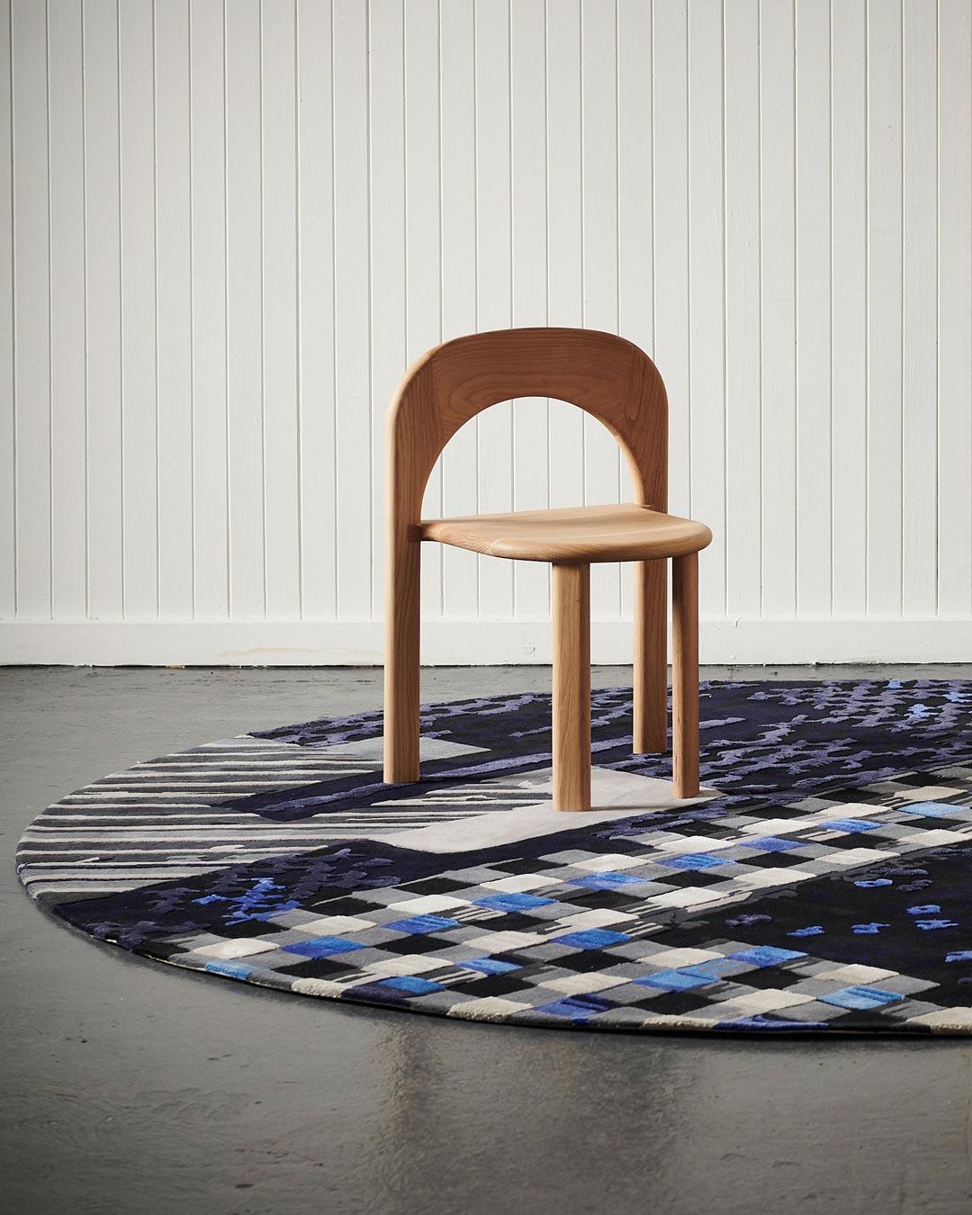 location shot of materiality 1 blue round rug by emma elizabeth designs