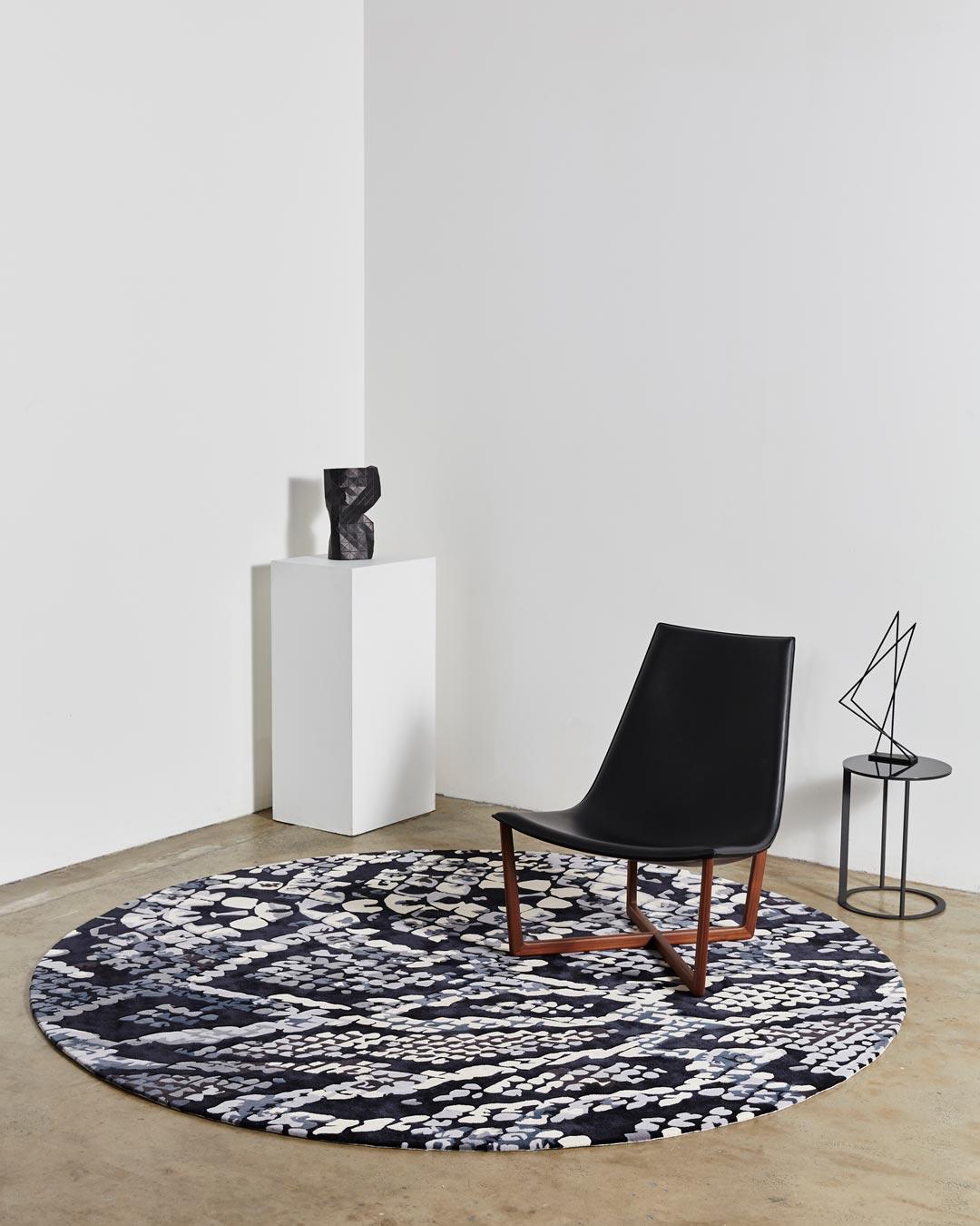 location shot of medusa rug by emma elizabeth designs round snake print