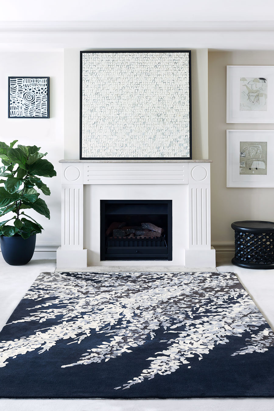 location living room shot of blossom dance rug by felicia aroney whote floral on navy background