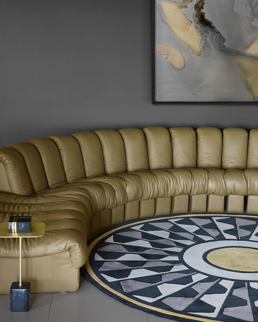 location living room shot of central park round rug by greg natale