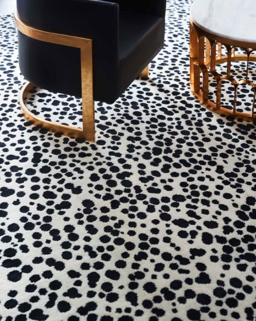 close up shot of dapple rug by greg natale black dots on white background